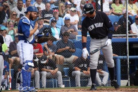 Jays new catcher, and former teammate Russell Martin  greets Alex Rodriguez as the fans serenade with boos. (EDDIE MICHELS PHOTO)