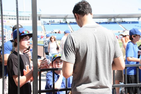 Two young gentlemen from St. Johns, NB get an autograph from fellow Canadian Jeff Francis today.  (EDDIE MICHELS PHOTO)
