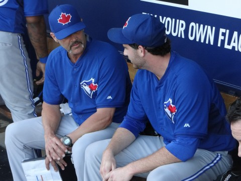 Blue Jays starter Drew Hutchinson (right) chats with Jays pitching coach Pete Walker.  went four innings allowing two runs on four hits while walking one and striking out three on 60-pitches, 35 for strikes. (EDDIE MICHELS PHOTO)