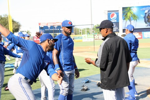 Jose Bautista (left) and Jose Reyes chat with Reggie Jackson prior to the game. (EDDIE MICHEL PHOTO)