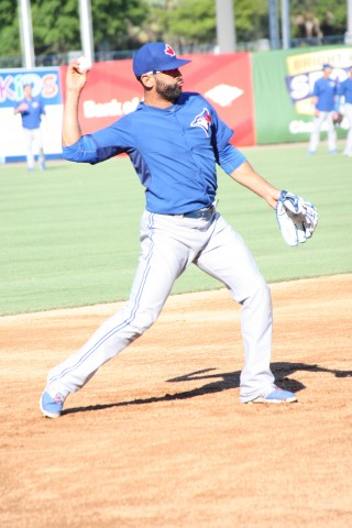 Bautista getting in some infield before the game, was 0 for 2 with an RBI. (EDDIE MICHEL PHOTO)