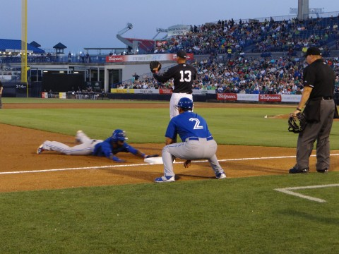 Alex Rodriguez (13) signals to hold the relay throw as Jose Reyes shows some speed with a triple. (EDDIE MICHEL PHOTO)