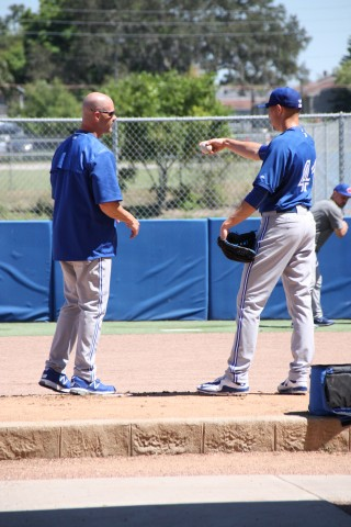 Blue Jays pitching coach Pete Walker goes over mechanics with RHP Aaron Sanchez after his bullpen session on St. Patrick's Day. (EDDIE MICHELS PHOTO)