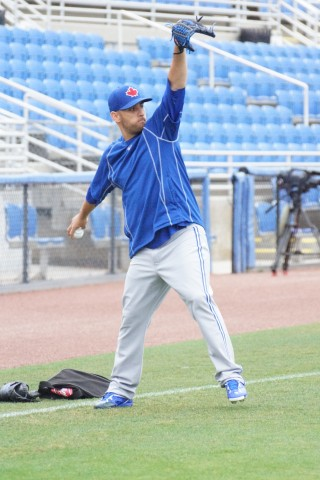 """Blue Jays right-hander Marco Estrada (right ankle) takes a break during throwing on Tuesday.  Estrada said he is scheduled to appear in a game on Saturday against the Braves split squad, """"I want to get back."""" (EDDIE MICHELS/PHOTO)"""