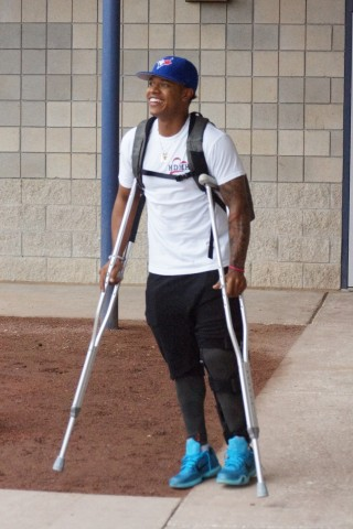 """Blue Jays pitcher Marcus Stroman (torn ACL left knee) sports a wide grin as he leaves the clubhouse to greet his teammates who stayed behind on the road trip Tuesday.  Stroman who was operated on by Dr. James Andrews on March 19th in Pensacola, Fl. to repair his knee said of being on crutches, """"I hope not much longer.""""  (EDDIE MICHELS PHOTO)"""