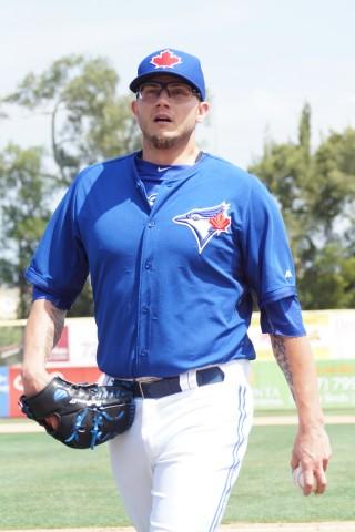 Brett Cecil walks off after his perfect inning (EDDIE MICHELS PHOTO)