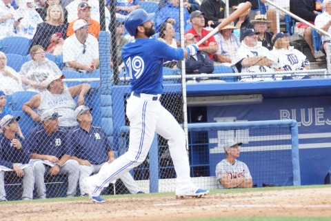 Outfielder Jose Bautista sends a 1-0 offering from Tigers reliever and loser Kyle Ryan over the left field fence giving the Blue Jays a 2-1 lead in route to a 4-1 win shortened to five innings by rain on Friday.  The homer was Bautista's fourth of the spring. (EDDIE MICHELS PHOTO)