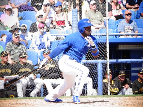 Dwight Smith, Jr. singles to right for one of the Jays three hits (EDDIE MICHELS PHOTO)