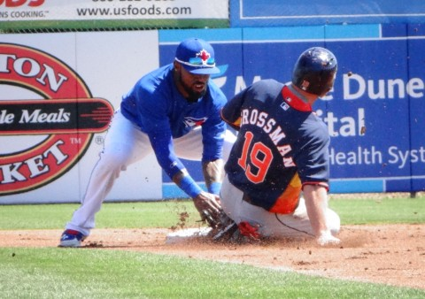 and tags out Astro's Robbie Grossman (EDDIE MICHELS PHOTO)
