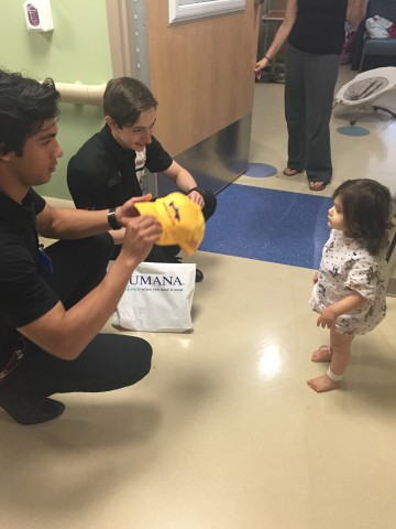 Neil Alberico and Zach Veach have goodies for Kaelyn (photo Brennie / RSEN)