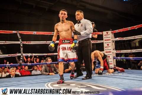 Santiago Arroyo (1-0, 1 KO) from Winter Haven, Florida. Trained by Tony Morgan the hungry Arroyo went right after Jose Garcia (0-1) who elected to cover up and hide on the ropes took a left hook to the body from Arroyo who was on the attack as evident mopped the ring with Garcia finishing him off at 2:08 of round one.(photo by Robert Richards)