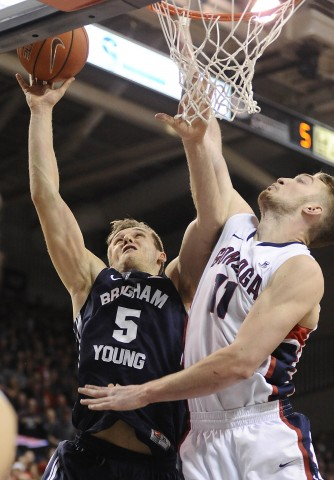 Brigham Young Cougars guard Kyle Collinsworth (5) goes over Gonzaga Bulldogs forward Domantas Sabonis (11) during the second half at McCarthey Athletic Center. The Cougars upset the Bulldogs 73-70. (photo USA TODAY Sports / James Snook)