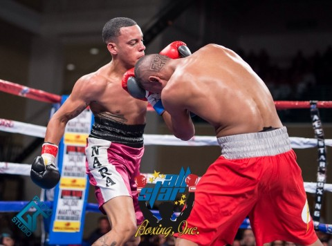 Featherweight Edgardo Marin (left) (1-3) from Humacao, Puerto Rico fed off the roaring Bori Bori fans traded with Alex Roman (2-1) issuing him hi first loss via unanimous decision all three judges scores 37-38 37-38 38-37 for Marin.  (photo ANGEL TORRES)