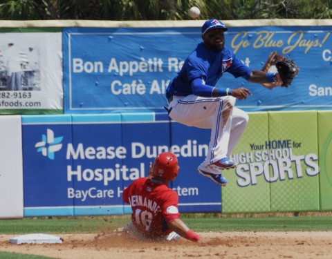 Blue Jays short stop Jose Reyes leaps to avoid Cesar Hernandez spikes to complete a double play in the top of the fourth on Monday. (EDDIE MICHELS PHOTO)