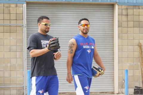 LHP Johan Santana on left,  (arm) and Macier Izturis (groin) arrive for a short workout at the Mattick Complex.  Izturis played catch with Santana who threw long toss from 105-feet. (EDDIE MICHELS/PHOTO)