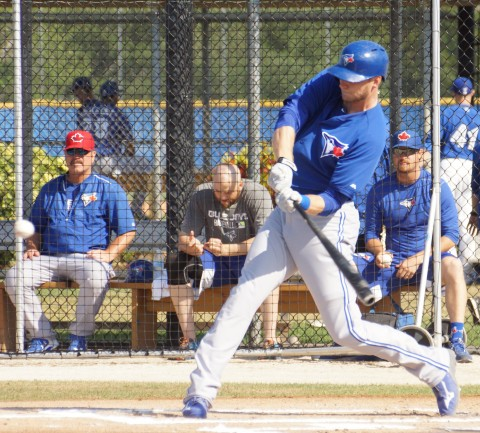 """Blue Jays outfielder Michael Saunders (left knee) singles to right but doesn't run it out on the last day of minor league camp on Sunday.  Saunders went 2-5 playing for Double-A New Hampshire against Triple-A Buffalo.  """"Tentatively I will DH for (Class-A) Dunedin on Thursday,"""" said Saunders who tore up his left knee on February 25th shagging balls on Field One at the Mattick Complex.  """"On Friday I will play the field if I pass all the tests,""""  Saunders continued of the physical tests he must pass just to DH. (EDDIE MICHELS PHOTO)"""