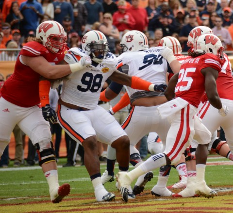 Sometimes the only way to slow down Gabe Wright (# 90 in center) is to grab a hold of his jersey like Wisconsin's Robert Havenstein is doing here in the 2015 Outback Bowl  (photo Travis Failey / RSEN)