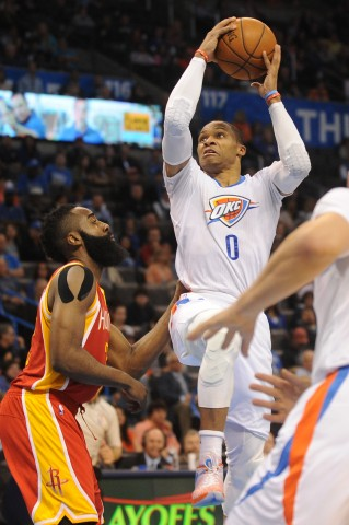 Thunder guard Russell Westbrook (0) shoots the ball as Houston Rockets guard James Harden (13) defends during the fourth quarter at Chesapeake Energy Arena.  (USA TODAY Sports /  Mark D. Smith)