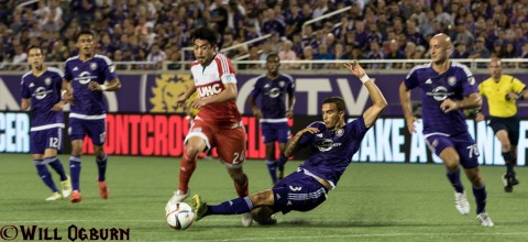 Revolution midfielder [24] Lee Nguyen defended by Seb Hines.  (photo WILL OGBURN)