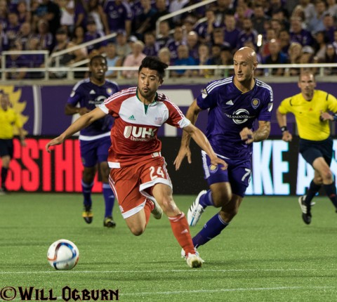 Lee Nguyen [24] of the Revoulution gets away from City's  Aurelien Collin (photo WILL OGBURN)