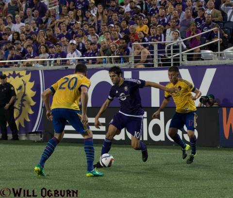 Kaka looks to get around Colorado defender Joseph Greenspan (20) with Dillon Serna right behind. (photo Will Ogburn)