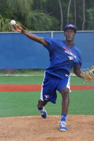 Former infielder Gustavo Pierre continues his transformation from infielder to pitcher throwing off the mound for the first time on Friday.  Pierre is working under the direction of Blue Jays minor league pitching coach Darold Knowles. (EDDIE MICHELS PHOTO)