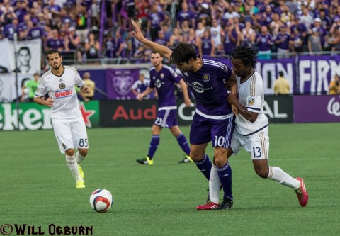 Kaka (10) being pushed by Michael Lahoud (13) (photo Will Ogburn)