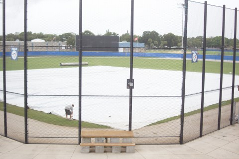 The ground crew working on the tarp (EDDIE MICHELS PHOTO)