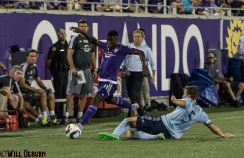Carlos Rivas gets a beat on Matt Besler (5) (photo WILL OGBURN)