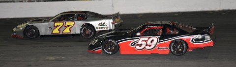 Drew Brannon (77) races Dustin Dunn (59) (photo by Rodney Meyering)