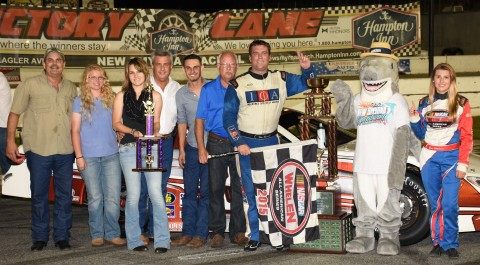 Tim Russell in victory lane with the Edwards family (photo by Rodney Meyering)