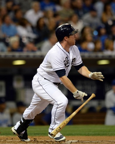 Sep 4, 2015; San Diego, CA, USA; San Diego Padres shortstop Jedd Gyorko (9) hits a solo home run during the third inning against the Los Angeles Dodgers at Petco Park. Mandatory Credit: Jake Roth-USA TODAY Sports