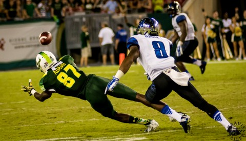 Rodney Adams dives in front of Arthur Maulet