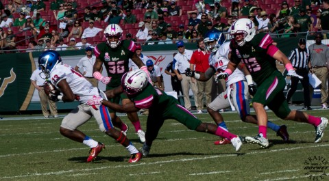 SMU's Ryheen Malone being cahsed by Auggie Sanchez (43) and company (Travis Failey / RSEN)