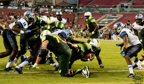 USF's Darius Tice dives for the opening touchdown