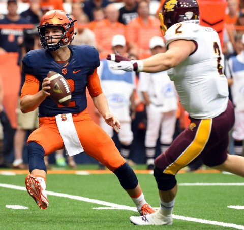 Syracuse Orange quarterback Eric Dungey (2) prepares to pitch the ball around Central Michigan Chippewas defensive lineman Blake Serpa (2)  at the Carrier Dome.  (photo by Rich Barnes-USA TODAY Sports)