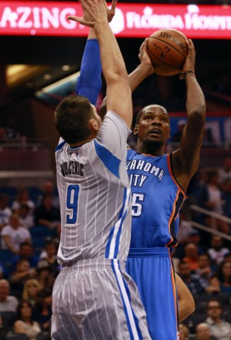 Oct 30, 2015; Orlando, FL, USA; Oklahoma City Thunder forward Kevin Durant (35) drives to the basket as Orlando Magic center Nikola Vucevic (9) defends during the first quarter at Amway Center. Mandatory Credit: Kim Klement-USA TODAY Sports
