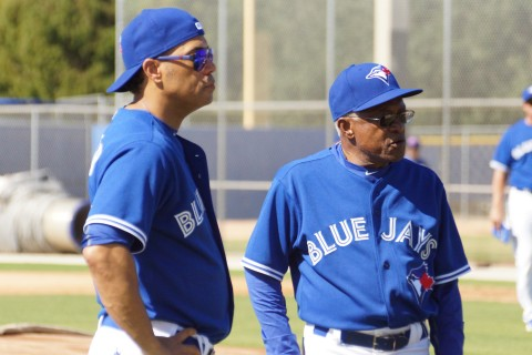 Hall of Famer Robbie Alomar and his father Sandy Alomar Sr. take a short break on Monday at the Blue Jays Fantasy Camp. EDDIE MICHELS PHOTO