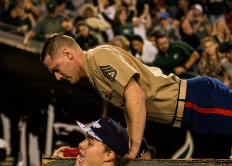 Staff Sergeant Lee celebrates USF's halftime lead by doing the push ceremony