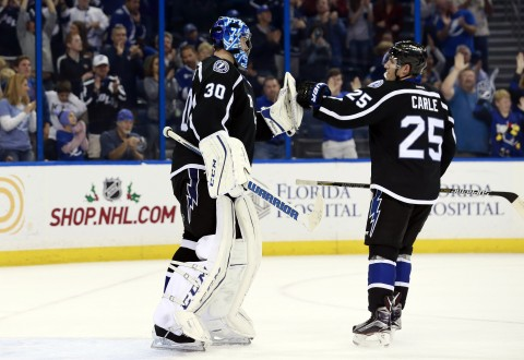 Nov 21, 2015; Tampa, FL, USA; Tampa Bay Lightning goalie Ben Bishop (30) is congratulated by defenseman Matt Carle (25) as he had a shut out against the Anaheim Ducks at Amalie Arena. Tampa Bay Lightning defeated the Anaheim Ducks 5-0. Mandatory Credit: Kim Klement-USA TODAY Sports