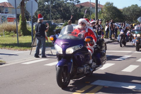 Right after the American Legion Riders guided the ride down Rt. 580 thru downtown Dunedin then up Alt 19 to AL Post 275 Santa Claus arrived at Post 275 safely. (EDDIE MICHELS PHOTO)