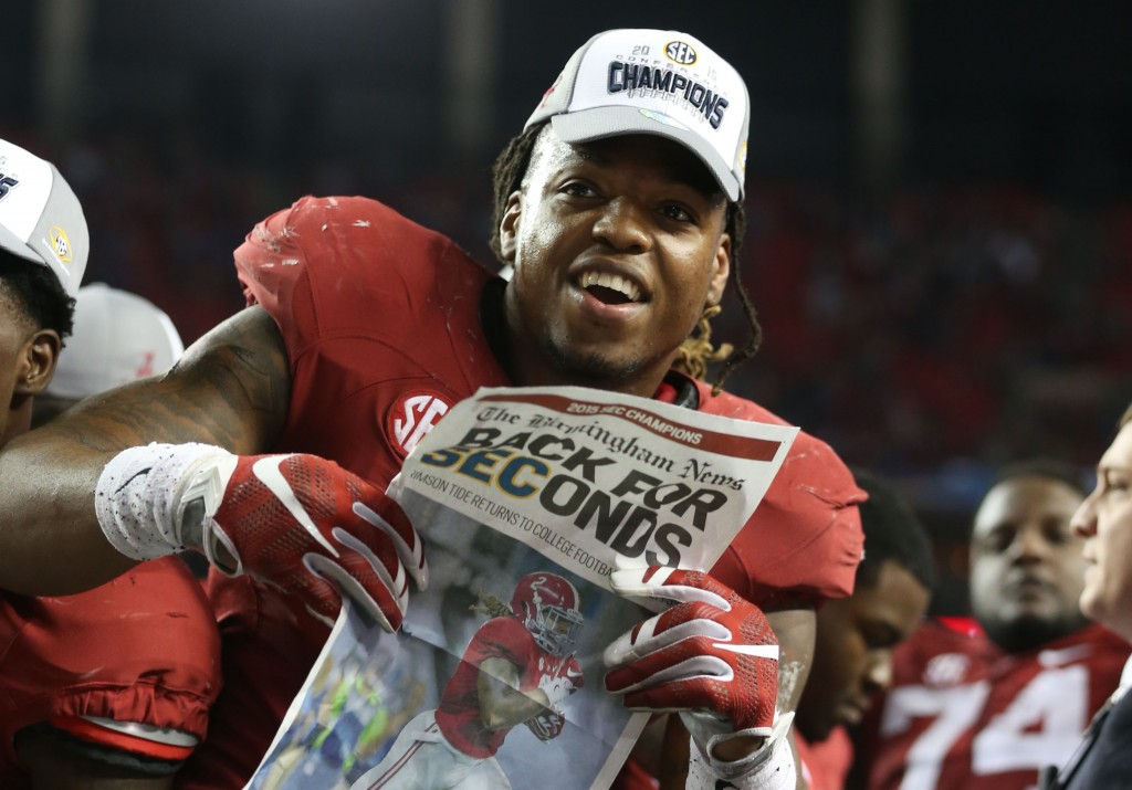 Derrick Henry celebrates his 29-15 win over the Florida Gators in the 2015 SEC Championship Game at the Georgia Dome. (photo Butch Dill / USA TODAY Sports)