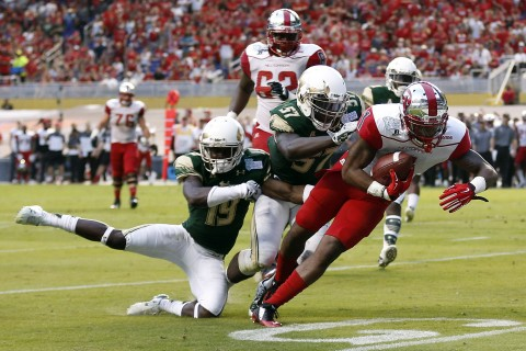Western Kentucky Hilltoppers wide receiver Nacarius Fant (1) gets paydirt before South Florida Bulls linebacker Nigel Harris (57) and cornerback Ronnie Hoggins (19) can make the stop. (photo Steve Mitchell / USA TODAY Sports)