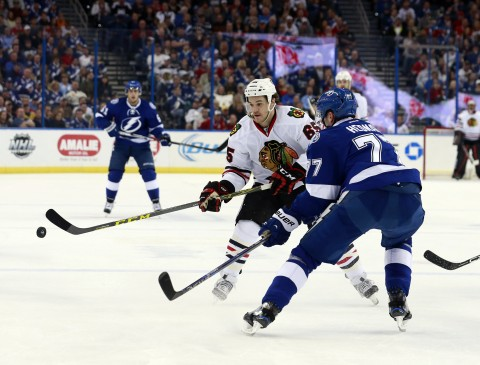 Andrew Shaw (65) works to get by Tampa Bay Lightning defenseman Victor Hedman (77) the game's number 1 star. (photo Kim Klement / USA TODAY Sports)