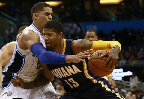 Paul George (13) drives on Orlando Magic forward Tobias Harris (12).  George lead the Pacers with 20 points and 7 rebounds. (photo Kim Klement / USA TODAY Sports)