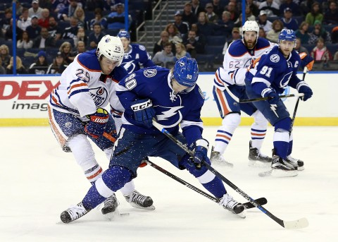 Oilers center Leon Draisaitl (29) defends Tampa Bay Lightning center Vladislav Namestnikov (90). (photo Kim Klement / USA TODAY Sports)