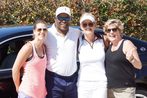 (Left to right) JennYarndley, Paula Wineck and Kim DeNoble with Tim Raines.  (EDDIE MICHELS PHOTO)