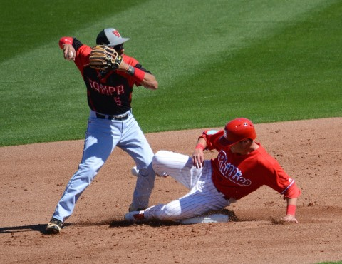 Philadelphia Phillies runner Andrew Knapp slides hard into second base as University of Tampa second baseman Laz Rivera makes the turn during Sunday's game. (Buck Davidson photo)
