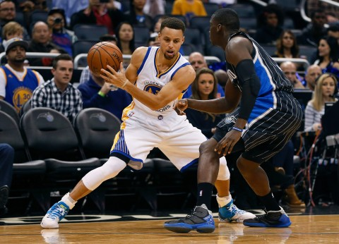 Stephen Curry looks to move around Orlando Magic guard Victor Oladipo. Curry dropped 51. (photo Reinhold Matay / USA TODAY Sports)