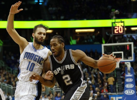 San Antonio Spurs forward Kawhi Leonard (2) drives to the basket as Orlando Magic guard Evan Fournier (10) attempts to defend during the second half at Amway Center. San Antonio defeated Orlando 98-96. (Kim Klement-USA TODAY Sports)